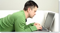 Man-on-sofa-laptop_tcm4-447351